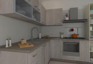 Dettaglio della cucina Corner: piano d'appoggio e vetrine nei pensili