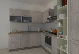 Vista dei pensili con vetrina, lavello e miscelatore della della Cucina angolare Corner